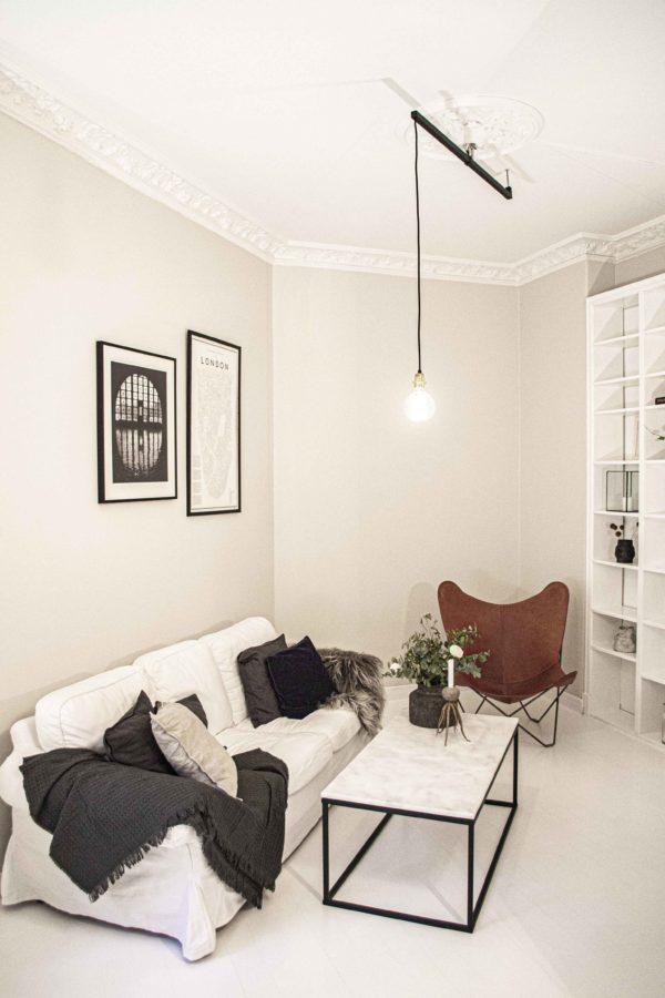 Svart förlängningsarm Vrida Light i vardagsrum