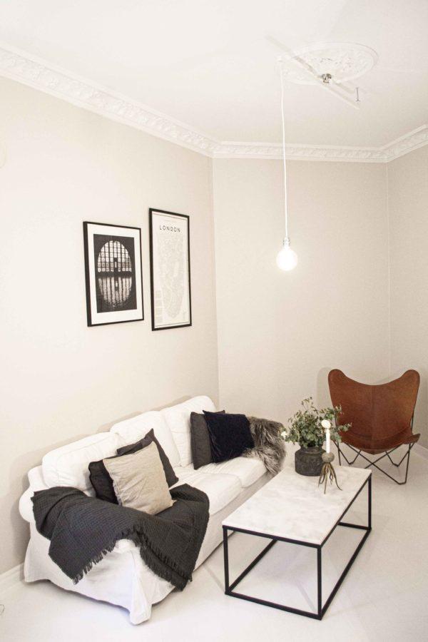 Vit förlängningsarm Vrida Light i vardagsrum